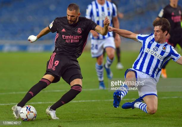 TOPSHOT Real Madrid's French forward Karim Benzema vies with Real Sociedad's Spanish defender Aritz Elustondo during the Spanish league football...