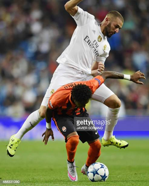 Real Madrid's French forward Karim Benzema vies with Shakhtar Donetsk's Brazilian midfielder Fred during the UEFA Champions League group A football...
