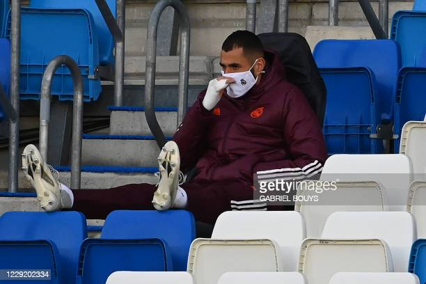 Real Madrid's French forward Karim Benzema waits for the start of the UEFA Champions League group B football match between Real Madrid and Shakhtar...