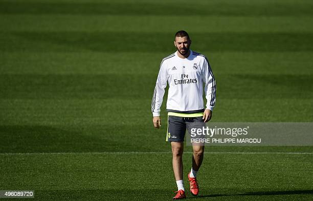 Real Madrid's French forward Karim Benzema walks during a training session at Valdebebas Sport City in Madrid on November 7 2015 on the eve of their...