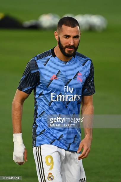 Real Madrid's French forward Karim Benzema warms up before the Spanish league football match Real Madrid CF against Getafe CF at the Alfredo di...