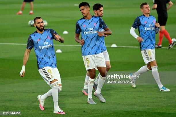 Real Madrid's French forward Karim Benzema warms up with teammates before the Spanish league football match between Real Madrid CF and Valencia CF at...
