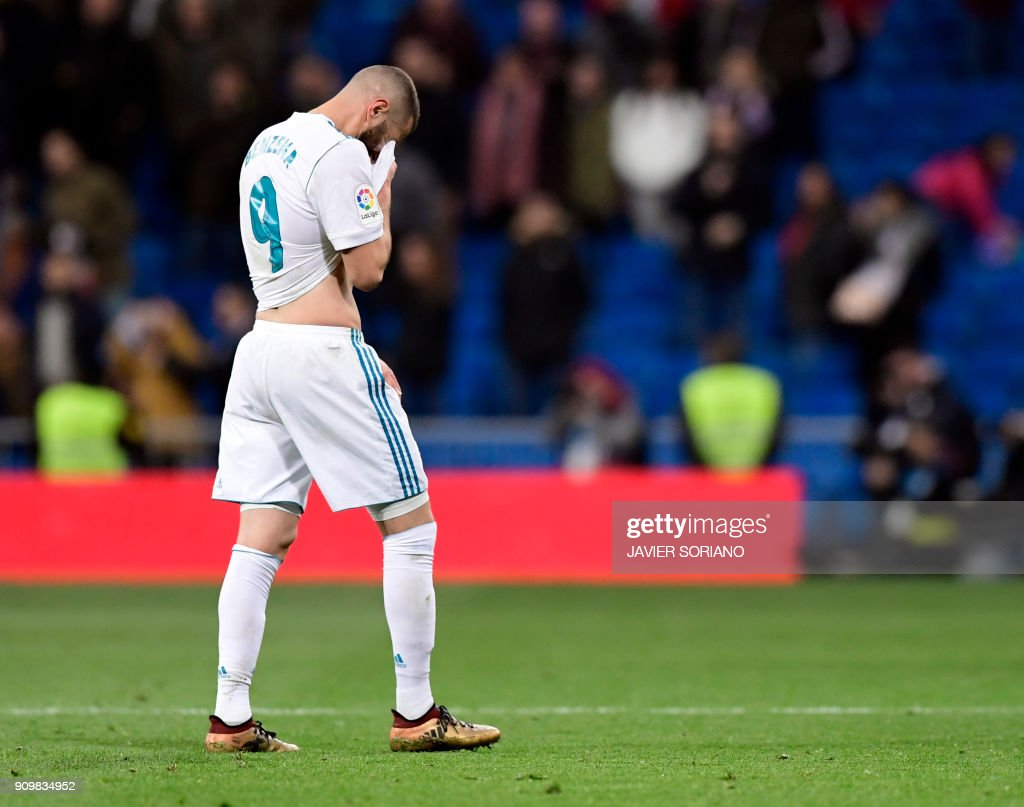 Real Madrid's French forward Karim Benzema wipes his face at the end of the Spanish 'Copa del Rey' (King's cup) quarter-final second leg football match between Real Madrid CF and CD Leganes at the Santiago Bernabeu stadium in Madrid on January 24, 2018. /