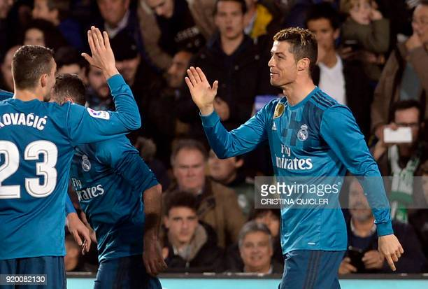 Real Madrid's French forward Real Madrid's Portuguese forward Cristiano Ronaldo celebrates scoring a goal with teammates during the Spanish league...