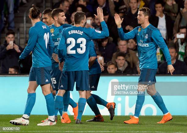 TOPSHOT Real Madrid's French forward Real Madrid's Portuguese forward Cristiano Ronaldo celebrates scoring a goal with teammates during the Spanish...