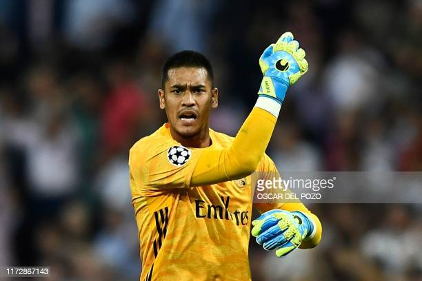 Real Madrid's French goalkeeper Alphonse Areola reacts during the UEFA Champions league Group A football match between Real Madrid and Club Brugge at...