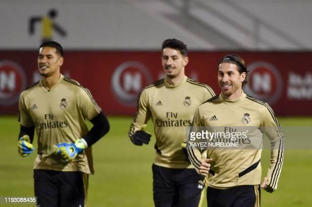 Real Madrid's French goalkeeper Alphonse Areola Real Madrid's Spanish goalkeeper Diego Altube and Real Madrid's Spanish defender Sergio Ramos attend...