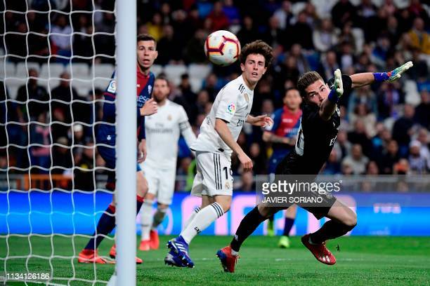 Real Madrid's French goalkeeper Luca Zidane fails to stop a goal during the Spanish League football match between Real Madrid CF and SD Huesca at the...