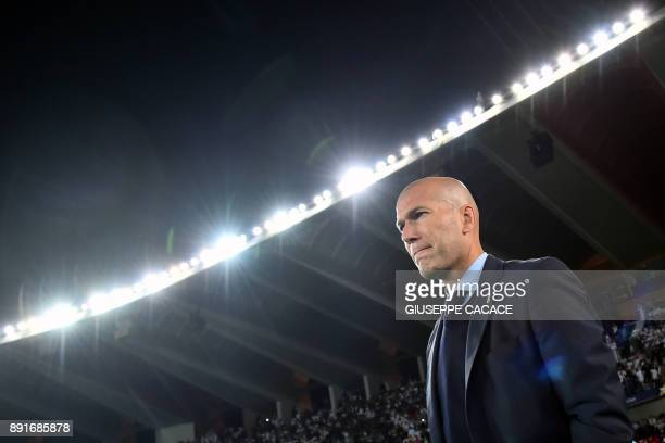 TOPSHOT Real Madrid's French head coach Zinedine Zidane looks on during the FIFA Club World Cup semifinal match in the Emirati capital Abu Dhabi on...