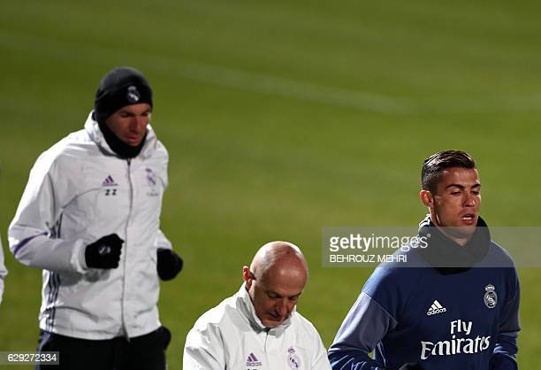Real Madrid's French headcoach Zinedine Zidane fitness coach Antonio Pintus and Portuguese forward Christiano Ronaldo run during a training session...