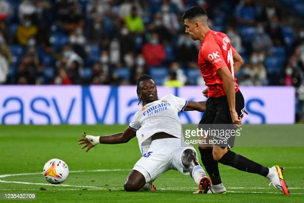 Real Madrid's French midfielder Eduardo Camavinga tackles Real Mallorca's Argentinian midfielder Rodrigo Battaglia during the Spanish League footbal...