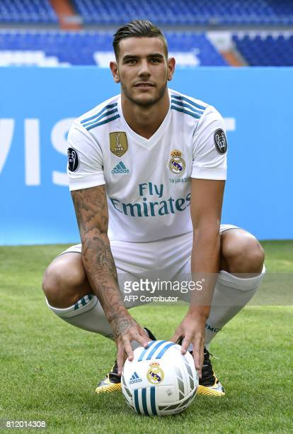 Real Madrid's French new player Theo Hernandez poses during his presentation at the Santiago Bernabeu stadium in Madrid on July 10 2017 / AFP PHOTO /...