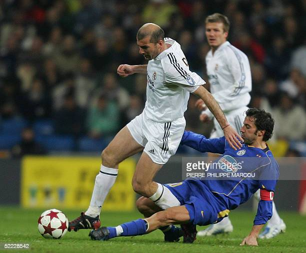 Real Madrid's French Zinedine Zidane is tackled by Juventus's Alessandro del Piero during their European Champions League football match in Madrid 22...