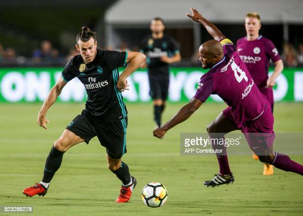 Real Madrid's Gareth Bale and Manchester City defender Vincent Kompany vie for the ball during their International Champions Cup football match on...