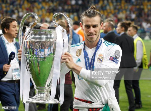 Real Madrid's Gareth Bale poses for a photo with the trophy after winning the UEFA Champions League final football match against Liverpool FC at the...