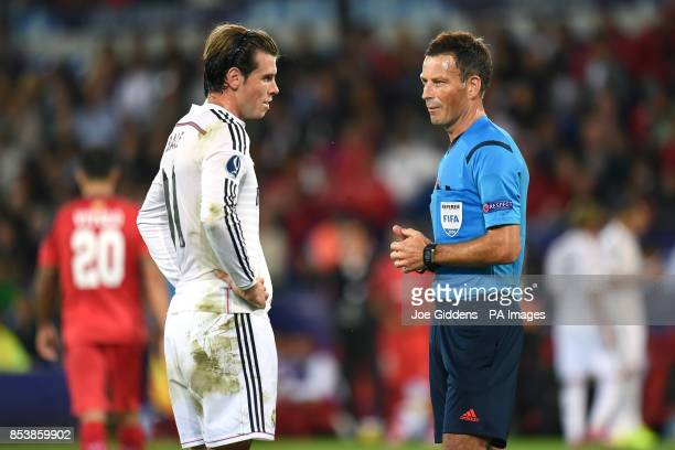 Real Madrid's Gareth Bale talks to referee Mark Clattenburg