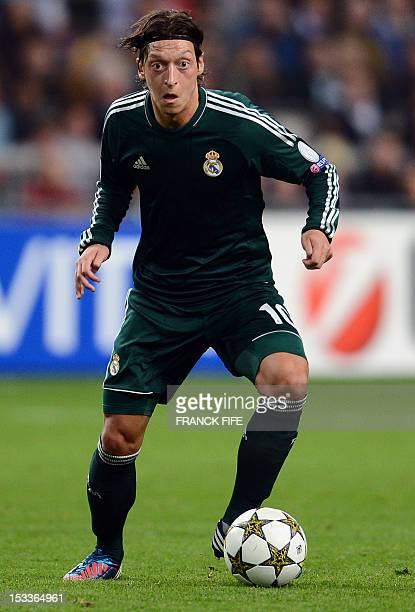 Real Madrid's German midfielder Mesut Ozil controls the ball during the UEFA Champions League Group D football match Ajax Amsterdam vs Real Madrid on...