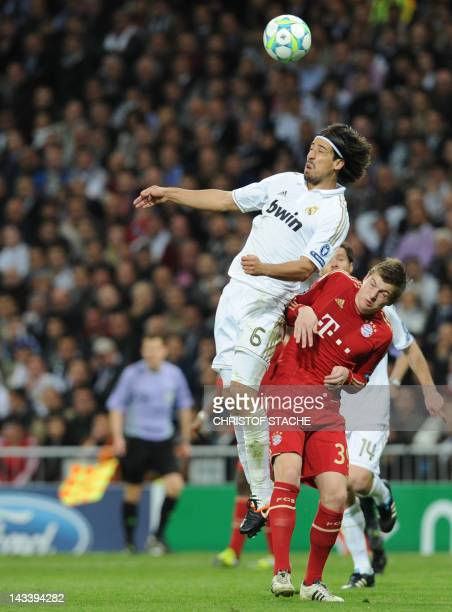 Real Madrid's German midfielder Sami Khedira heads the ball by Bayern Munich's midfielder Toni Kroos during the UEFA Champions League second leg...
