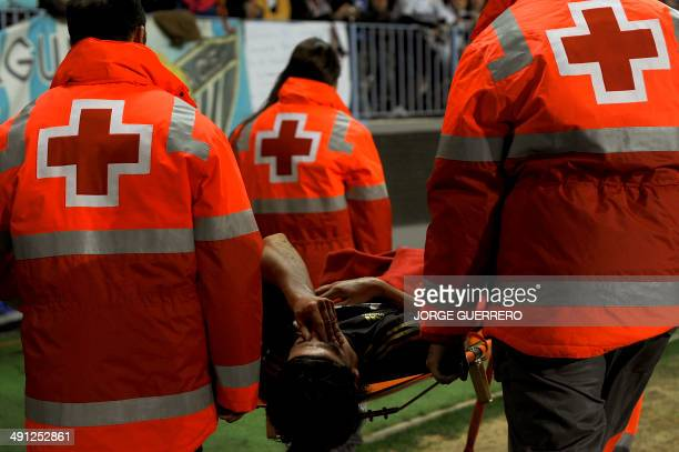 Real Madrid's German midfielder Sami Khedira leaves the field on a stretcher after sufering an injury gestures in pain during the Spanish Cup...