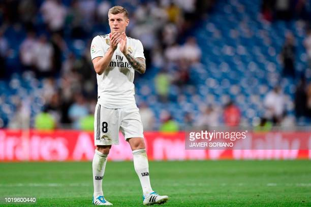Real Madrid's German midfielder Toni Kroos acknowledges fans at the end of the Spanish League football match between Real Madrid and Getafe at the...