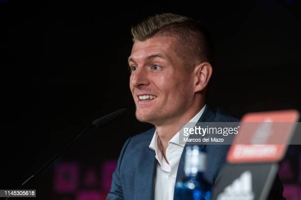 Real Madrid's German midfielder Toni Kroos announces the renewal of his contract with Real Madrid until 2023 in Santiago Bernabeu Stadium