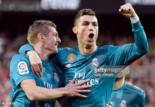 Real Madrid's German midfielder Toni Kroos celebrates a goal with Real Madrid's Portuguese forward Cristiano Ronaldo during the Spanish league...