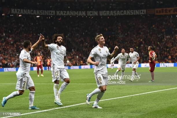 Real Madrid's German midfielder Toni Kroos celebrates after scoring a goal during the UEFA Champions League group A football match between...
