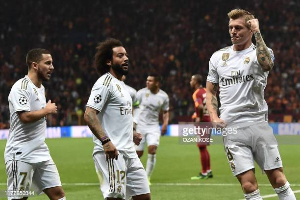 TOPSHOT Real Madrid's German midfielder Toni Kroos celebrates after scoring a goal during the UEFA Champions League group A football match between...