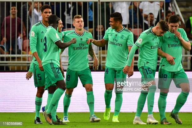 Real Madrid's German midfielder Toni Kroos celebrates his goal teammates during the Spanish Super Cup semi final between Valencia and Real Madrid on...