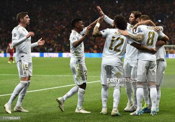 Real Madrid's German midfielder Toni Kroos celebrates with team mates after he scored a goal during the UEFA Champions League group A football match...