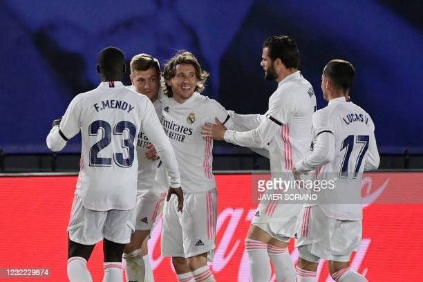 """Real Madrid's German midfielder Toni Kroos celebrates with teammates after scoring during the """"El Clasico"""" Spanish League football match between Real..."""