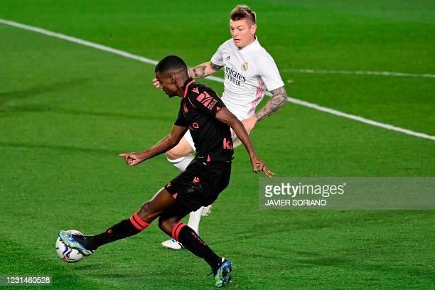 Real Madrid's German midfielder Toni Kroos challenges Real Sociedad's Swedish forward Alexander Isak during the Spanish league football match between...