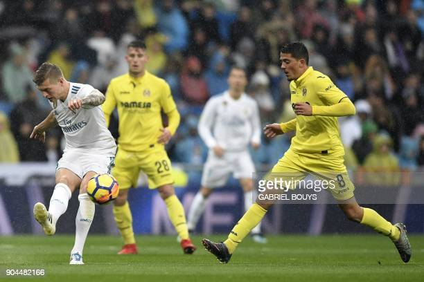Real Madrid's German midfielder Toni Kroos challenges Villarreal's Spanish midfielder Pablo Fornals during the Spanish league football match between...
