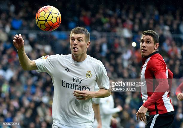 Real Madrid's German midfielder Toni Kroos controls a ball next to Athletic Bilbao's midfielder Gorka Elustondo during the Spanish league football...