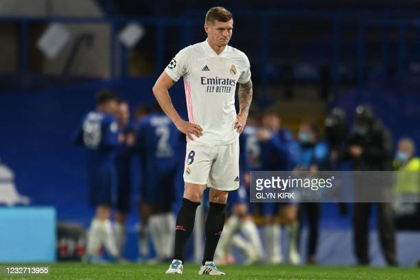 Real Madrid's German midfielder Toni Kroos reacts after conceding a second goal during the UEFA Champions League second leg semi-final football match...