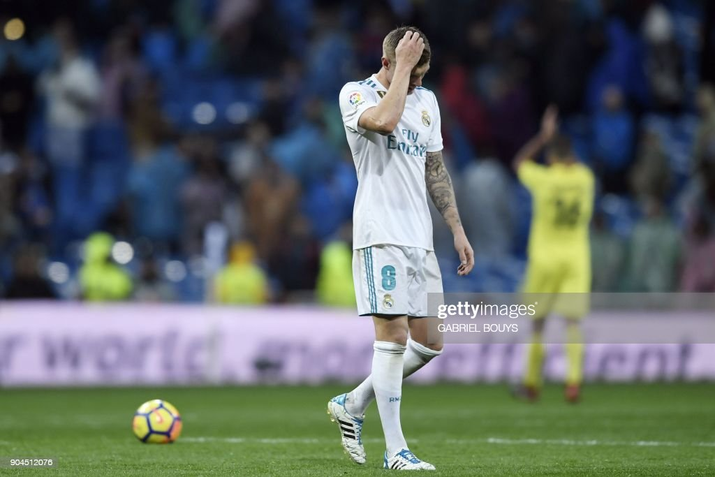 Real Madrid's German midfielder Toni Kroos reacts at the end of the Spanish league football match between Real Madrid and Villarreal at the Santiago Bernabeu Stadium in Madrid on January 13, 2018. /