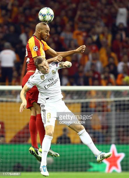 Real Madrid's German midfielder Toni Kroos vies for the ball with Galatasaray's French midfielder Steven Nzonzi during the UEFA Champions League...