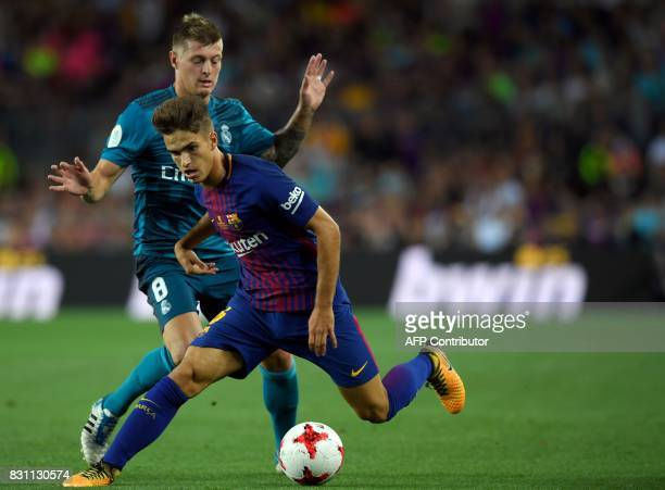 Real Madrid's German midfielder Toni Kroos vies with Barcelona's midfielder Denis Suarez during the Spanish Supercup first leg football match FC...