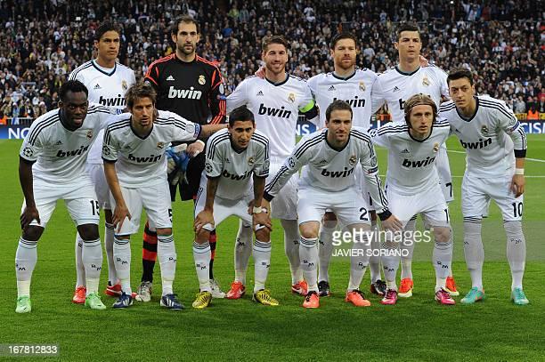Real Madrid's Ghanaian midfielder Michael Essien Real Madrid's Portuguese defender Fabio Coentrao Real Madrid's Argentinian midfielder Angel di Maria...