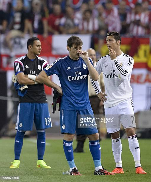 Real Madrid's goalkeeper and captain Iker Casillas and Real Madrid's Portuguese forward Cristiano Ronaldo react at the end of the Spanish Supercopa...