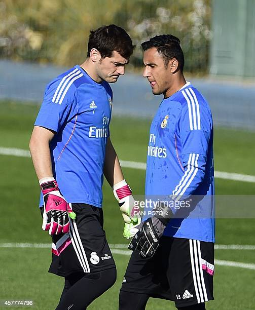 Real Madrid's goalkeeper and captain Iker Casillas and Real Madrid's Costa Rican goalkeeper Keylor Navas take part in a training session on the eve...