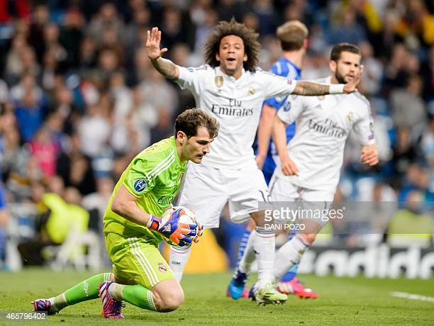 Real Madrid's goalkeeper and captain Iker Casillas blocks the ball during the round of 16 second leg UEFA Champions League football match Real Madrid...
