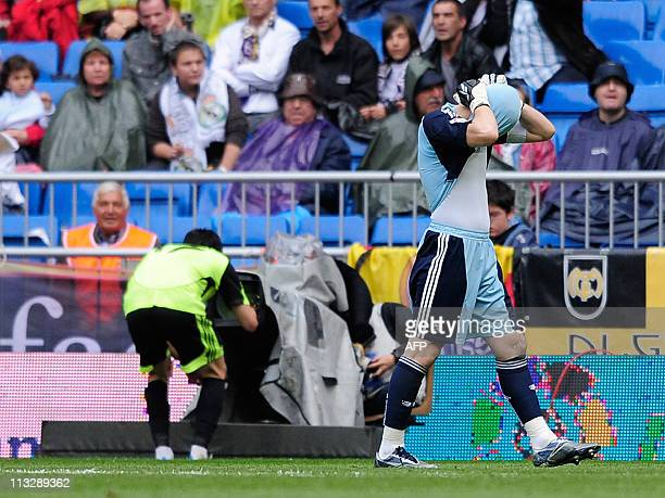 Real Madrid's goalkeeper and captain Iker Casillas gestures as Zaragoza's midfielder Angel Lafita celebrates scoring on April 30 2011 during their...