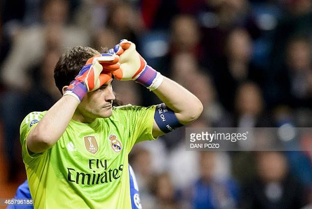 Real Madrid's goalkeeper and captain Iker Casillas gestures during the round of 16 second leg UEFA Champions League football match Real Madrid CF vs...