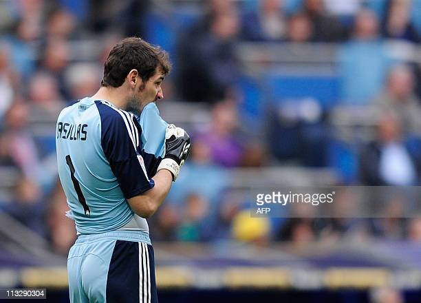 Real Madrid's goalkeeper and captain Iker Casillas reacts after the Spanish league football match Real Madrid against Zaragoza at the Santiago...