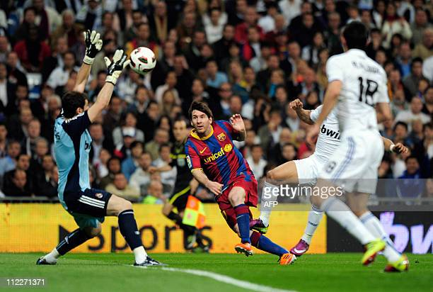 Real Madrid's goalkeeper and captain Iker Casillas vies with Barcelona's Argentinian forward Lionel Messi during 'El Clasico' Spanish League football...