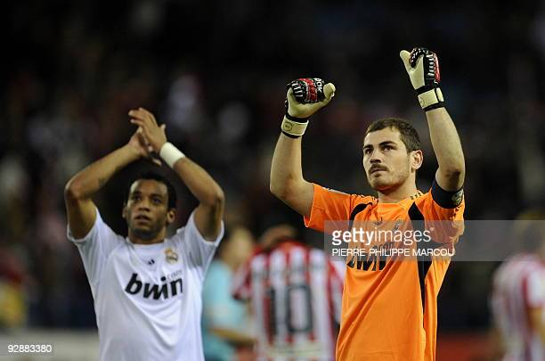 Real Madrid's goalkeeper Iker Casillas and Real Madrid's Brazilian defender Marcelo celebrate after the Spanish League football match against...