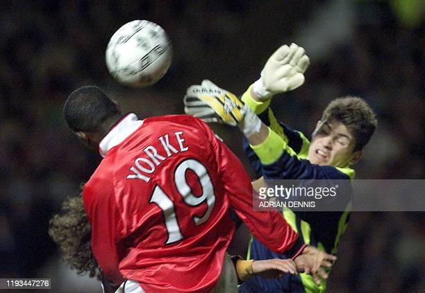 Real Madrid's goalkeeper Iker Casillas goes to punch the ball against Manchester United's Dwight Yorke during the UEFA Champions League quarter final...