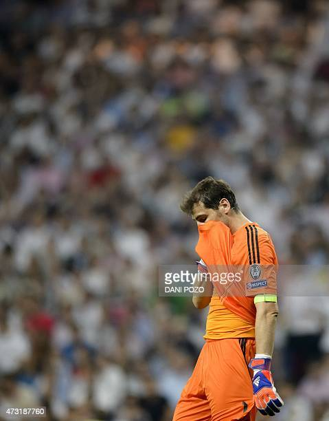 Real Madrid's goalkeeper Iker Casillas grabs his jersey at the end of the UEFA Champions League semifinal second leg football match Real Madrid FC vs...