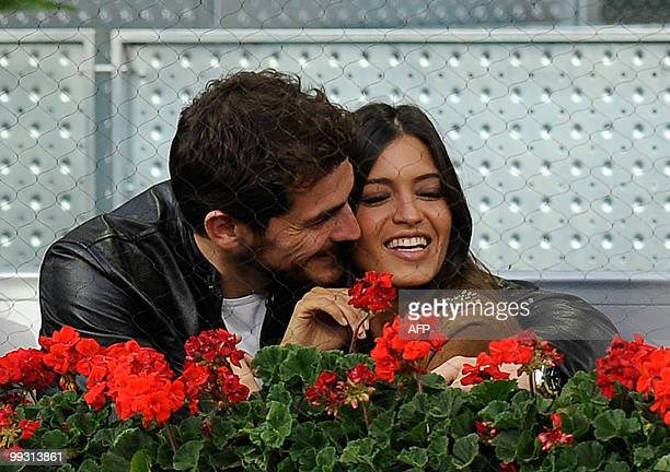 Real Madrid's Goalkeeper Iker Casillas kisses his girlfriend Sara Carbonero during the match between Switzerland's Roger Federer against Latvia's...